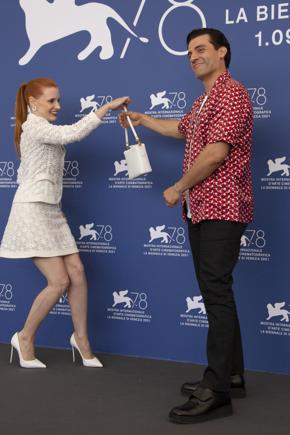 Oscar Isaac, right, and Jessica Chastain pose for photographers at the photo call for the film 'Scenes of a Marriage' during the 78th edition of the Venice Film Festival in Venice, Italy, Saturday, Sep, 4, 2021. (Photo by Joel C Ryan/Invision/AP)