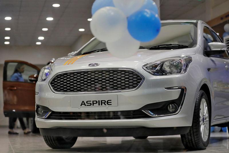 A new Ford Aspire car is on display for sale inside a showroom in New Delhi