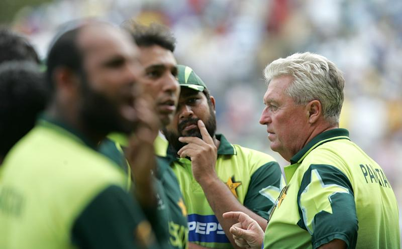 Pakistan players with coach Bob Woolmer during the World Cup match in Jamaica. (AP Photo/B.K.Bangash)