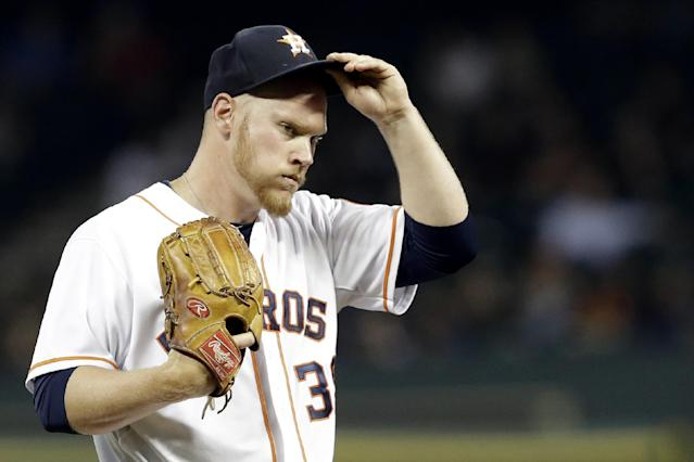 Houston Astros starting pitcher Brett Oberholtzer adjusts his cap after walking New York Yankees' Derek Jeter to load the bases in the third inning of a baseball game on Thursday, April 3, 2014, in Houston. (AP Photo/Pat Sullivan)