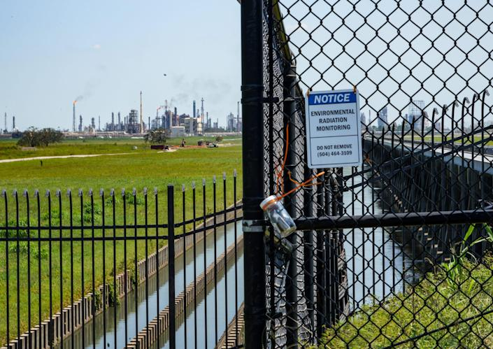 A sign warns people not to disturb a radiation-monitoring system near refineries along the Mississippi River outside New Orleans.