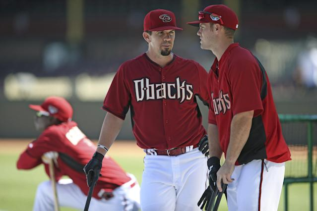 Arizona Diamondbacks' Tuffy Gosewisch, left, and Chris Owings chat each other during batting practice at the Sydney Cricket Ground in Sydney, Thursday, March 20, 2014. The Diamondbacks and the Los Angeles Dodgers open the MLB regular baseball season with games on Saturday and Sunday. (AP Photo/Rick Rycroft)
