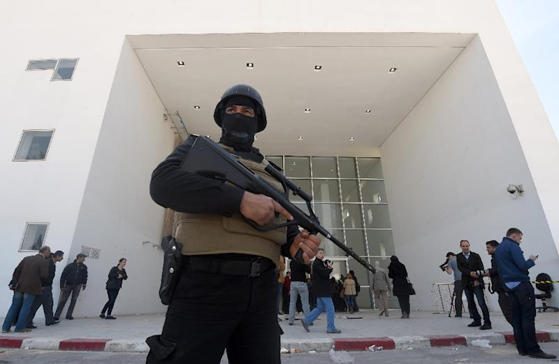 A member of the Tunisian security forces stands guard at the visitors' entrance of the National Bardo Museum in Tunis, in the aftermath of an attack on foreign tourists on March 19, 2015
