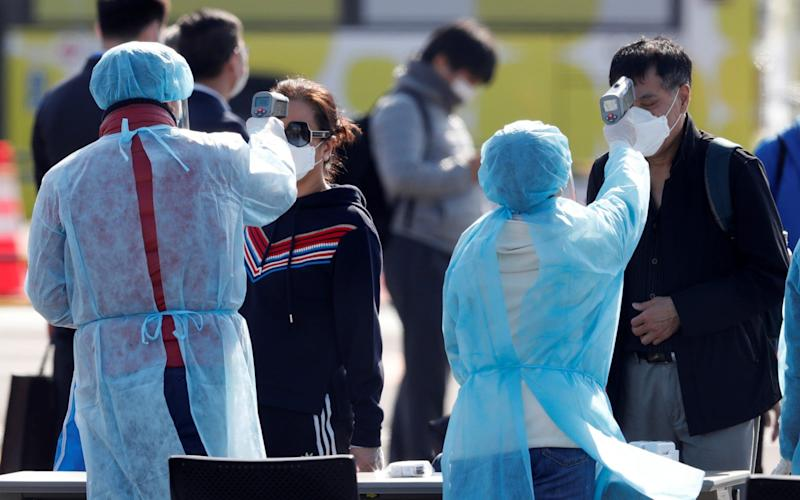 Passengers were scanned as they left the cruise ship on Friday - KIM KYUNG-HOON/REUTERS