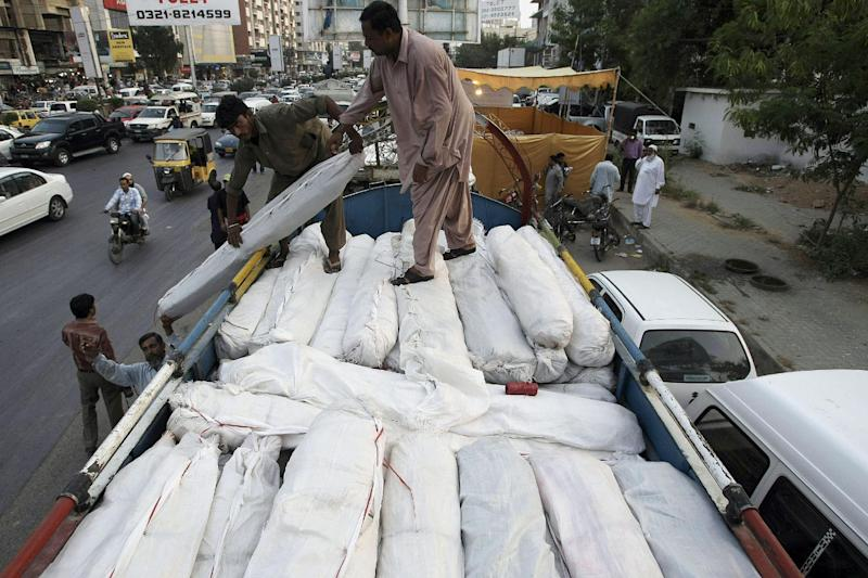 Pakistani volunteers load tents and other relief supplies into a truck to send it for earthquake-affected areas of the Baluchistan province, in Karachi, Pakistan, Saturday, Sept. 28, 2013. A major earthquake rocked Pakistan's southwest Saturday, sending people running into the street in panic just days after another quake in the same region killed hundreds of people, officials said. (AP Photo/Fareed Khan)