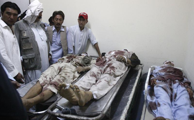 Pakistani Shiite Muslims identify the bodies of their relatives, killed by unknown gunmen, at a local hospital in Quetta, Pakistan on Saturday, Sept. 1, 2012. A group of gunmen on motorcycles in the southwestern province of Baluchistan killed several Shiite Muslims, as violence against the minority sect continues to escalate. (AP Photo/Arshad Butt)