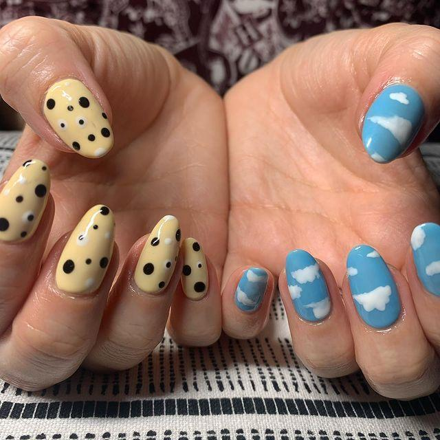 """<p> Can't choose between two looks? Hannah Montana it and get the best of both worlds with one look on each hand. </p><p>This trend is already rooting itself in salons across the UK, but mark our words, it'll take off in 2021. Tip: pick patterns and colours across a particular theme to give the contrast a sense of cohesion. Wham, bam, you've got the coolest nails on Instagram.</p><p><a href=""""https://www.instagram.com/p/B7EibW-FG-y/"""" rel=""""nofollow noopener"""" target=""""_blank"""" data-ylk=""""slk:See the original post on Instagram"""" class=""""link rapid-noclick-resp"""">See the original post on Instagram</a></p>"""