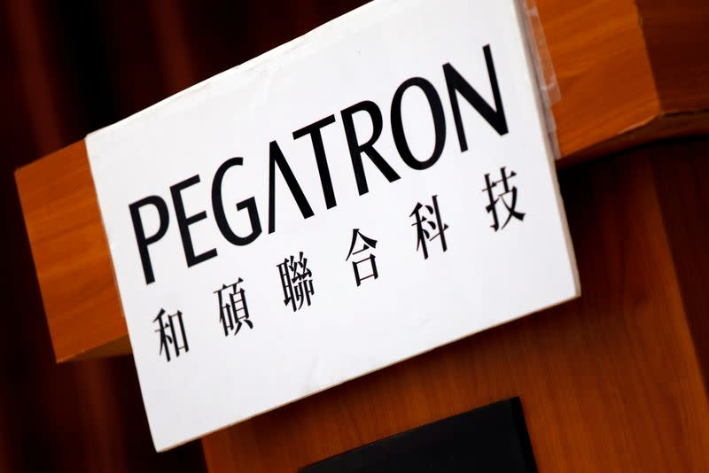 The logo of Pegatron, which assembles electronics from Apple Inc's iPhones, is seen during an annual general meeting in Taipei