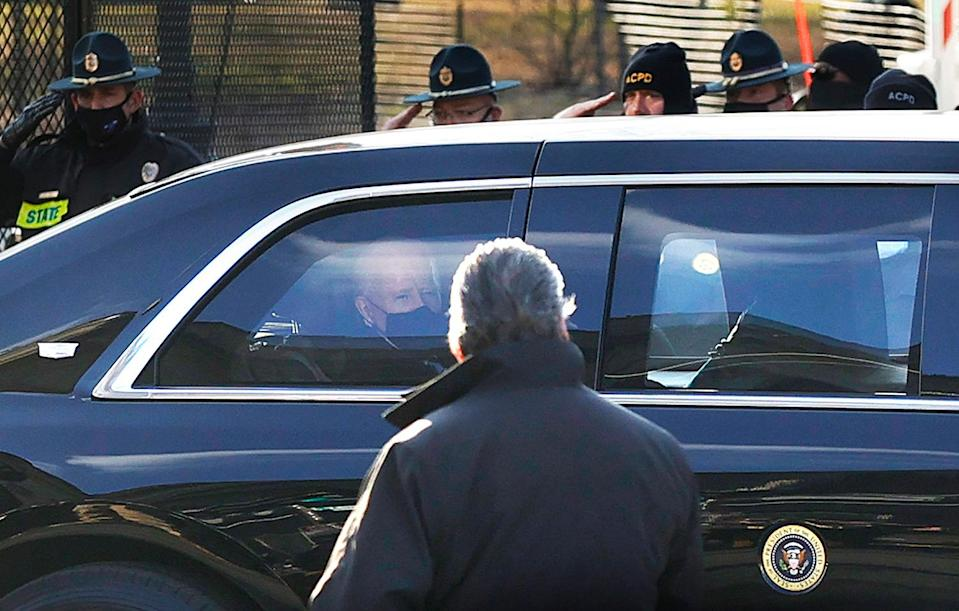 <p>After being sworn in as the 46th President, Biden rides in his limo while police officers salute him.</p>