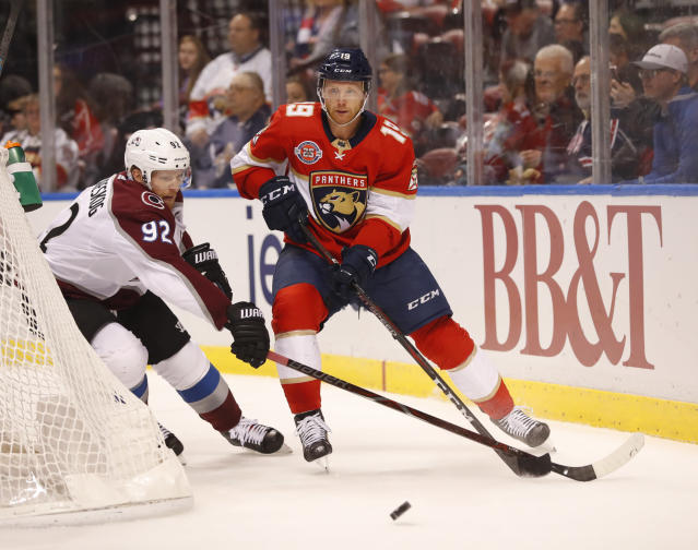 Colorado Avalanche left wing Gabriel Landeskog (92) and Florida Panthers defenseman Mike Matheson (19) battle for the puck during the first period of an NHL hockey game, Thursday, Dec. 6, 2018, in Sunrise, Fla. (AP Photo/Wilfredo Lee)