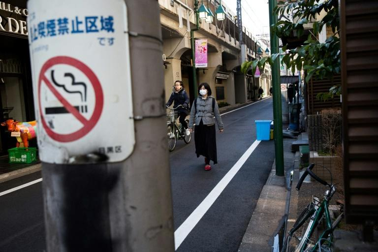 Smoking in the street is already banned in many places in Japan, under local regulations that impose hefty fines on violators