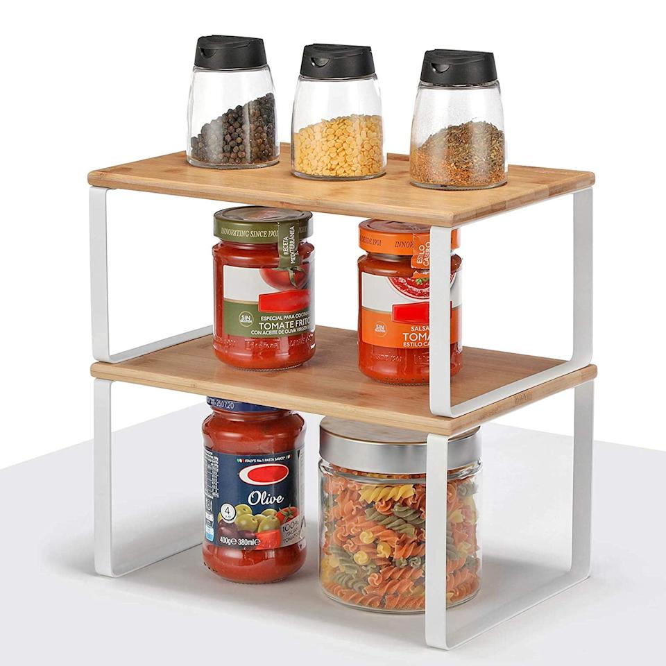 """<p>If you're looking for something that's not all metal, get this modern-style <a href=""""https://www.popsugar.com/buy/Songmics-Cabinet-Shelf-Organizer-542909?p_name=%20Songmics%20Cabinet%20Shelf%20Organizer&retailer=amazon.com&pid=542909&price=22&evar1=casa%3Aus&evar9=47137466&evar98=https%3A%2F%2Fwww.popsugar.com%2Fphoto-gallery%2F47137466%2Fimage%2F47137605%2FSongmics-Cabinet-Shelf-Organizer&list1=organization%2Ckitchens%2Csmall%20space%20living%2Chome%20organization%2Chome%20shopping&prop13=api&pdata=1"""" rel=""""nofollow"""" data-shoppable-link=""""1"""" target=""""_blank"""" class=""""ga-track"""" data-ga-category=""""Related"""" data-ga-label=""""https://www.amazon.com/SONGMICS-Organizer-Stackable-Expandable-UKCS02NW/dp/B07XMBSGKZ/ref=sr_1_47?crid=35ZO9H2SU4R5A&amp;keywords=can+organizer+for+pantry&amp;qid=1579801488&amp;sprefix=can+or%2Caps%2C215&amp;sr=8-47"""" data-ga-action=""""In-Line Links""""> Songmics Cabinet Shelf Organizer </a> ($22).</p>"""