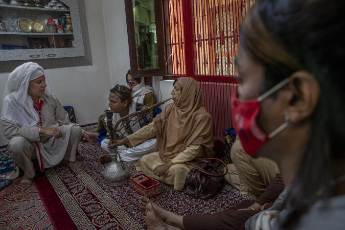 Transgender Kashmiris interact during a special meet of their community members in Srinagar, Indian controlled Kashmir, Thursday, June 3, 2021. Many of Kashmir's transgender people face domestic abuse and end up running away from families at an early age. Some lack housing, education and other basic resources. Living in the shadows of conflict, coupled with the recent crisis of the pandemic, has pushed the community further to the margins. (AP Photo/ Dar Yasin)