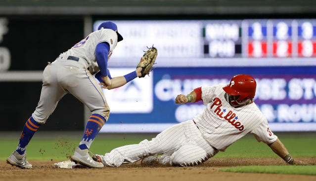Philadelphia Phillies' Jorge Alfaro, right, steals second base past the tag from New York Mets second baseman Jeff McNeil during the second inning of a baseball game Tuesday, Sept. 18, 2018, in Philadelphia. (AP Photo/Matt Slocum)