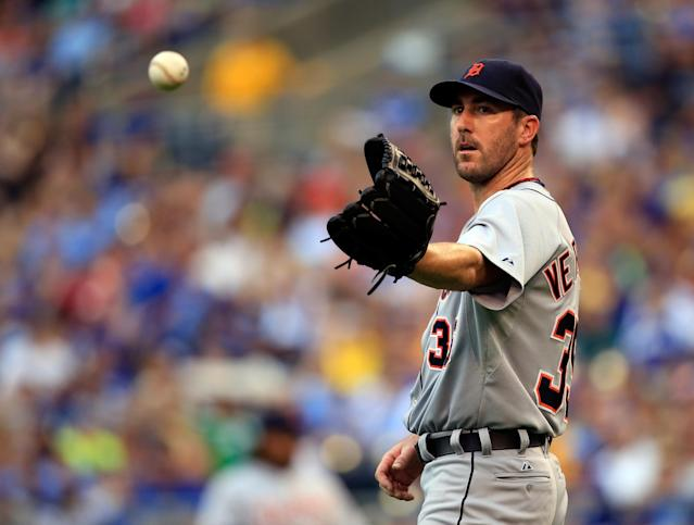 KANSAS CITY, MO - JULY 20: Starting pitcher Justin Verlander #35 of the Detroit Tigers reaches for the ball after giving up a walk during the game against the Kansas City Royals at Kauffman Stadium on July 20, 2013 in Kansas City, Missouri. (Photo by Jamie Squire/Getty Images)