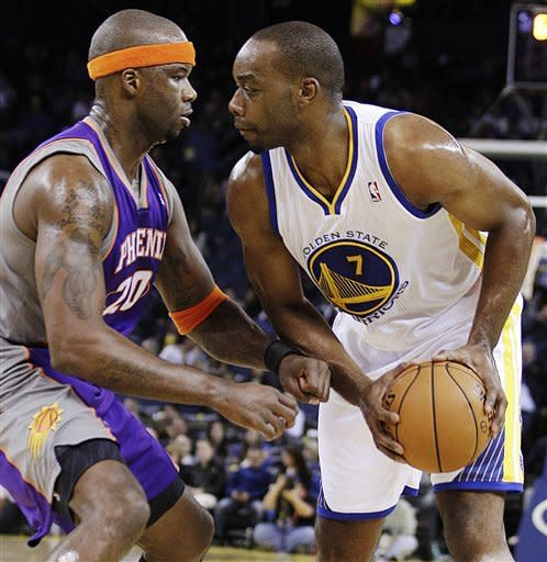 Phoenix Suns' Jermaine O'Neal, left, defends against Golden State Warriors' Carl Landry during the second half of an NBA preseason basketball game, Tuesday, Oct. 23, 2012, in Oakland, Calif. (AP Photo/Ben Margot)