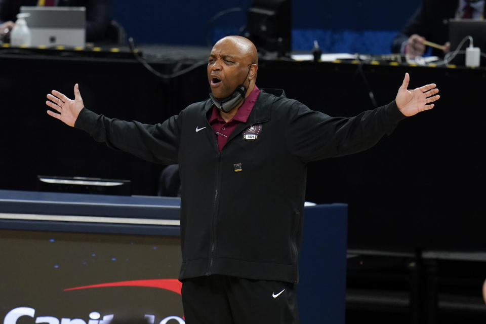 Florida State head coach Leonard Hamilton questions a call during the first half of a Sweet 16 game against Michigan in the NCAA men's college basketball tournament at Bankers Life Fieldhouse, Sunday, March 28, 2021, in Indianapolis. (AP Photo/Jeff Roberson)