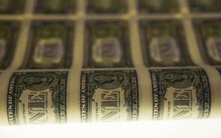 A sheet of United States one dollar bills is seen on a light table during production at the Bureau of Engraving and Printing in Washington