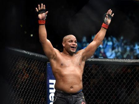 FILE PHOTO: Jan 20, 2018; Boston, MA, USA; Daniel Cormier (red gloves) celebrates his victory against Volkan Oezdemir (not seen) during UFC 220 at the TD Garden. Mandatory Credit: Bob DeChiara-USA TODAY Sports