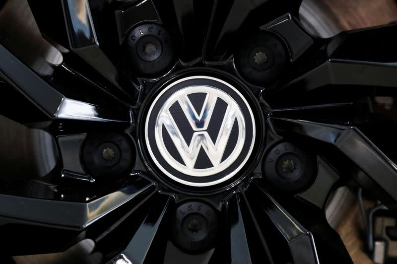 The logo of German carmaker Volkswagen is seen on a rim cap in a showroom of a Volkswagen car dealer in Brussels