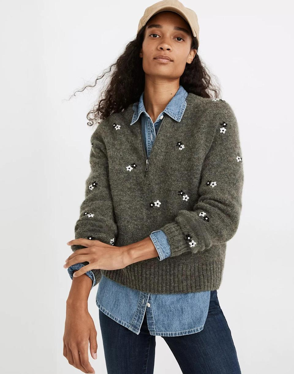 """A printed half-zip like this one is a fall wardrobe VIP—and quintessential in pulling looks together before your first morning espresso. $110, Madewell. <a href=""""https://www.madewell.com/embroidered-enfield-half-zip-sweater-NA807.html"""" rel=""""nofollow noopener"""" target=""""_blank"""" data-ylk=""""slk:Get it now!"""" class=""""link rapid-noclick-resp"""">Get it now!</a>"""