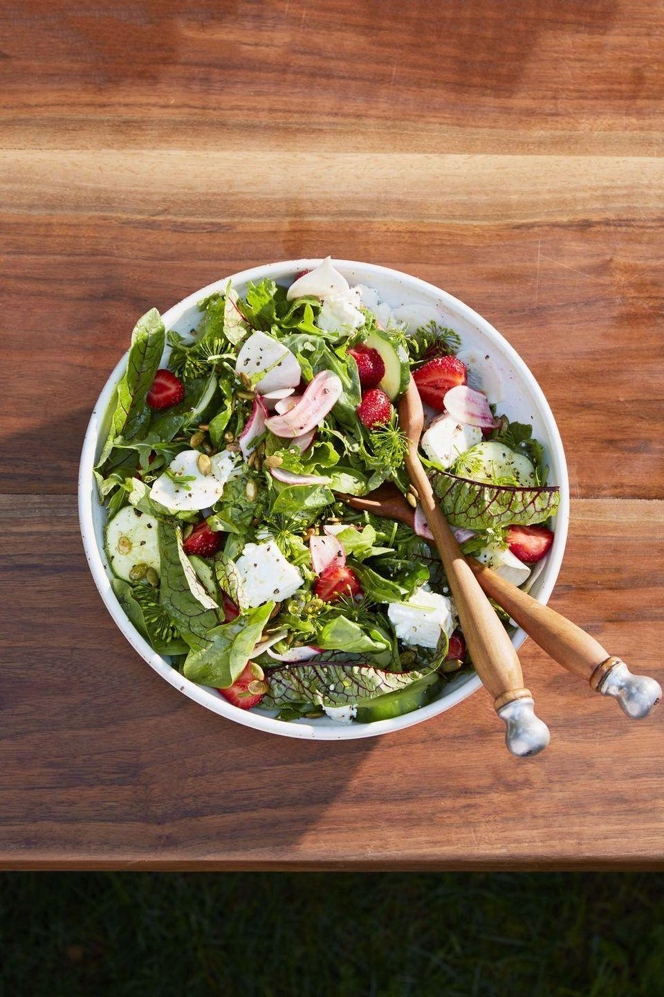 """<p>This spring salad gets a big flavor boost from the honey-lemon vinaigrette.</p><p><strong><a href=""""https://www.countryliving.com/food-drinks/a32353851/green-salad-with-turnips-strawberries-and-pepitas/"""" rel=""""nofollow noopener"""" target=""""_blank"""" data-ylk=""""slk:Get the recipe"""" class=""""link rapid-noclick-resp"""">Get the recipe</a>.</strong></p>"""