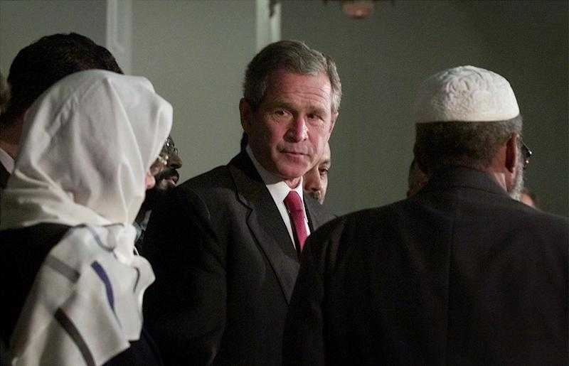 President George W. Bush meets with Muslim religious leaders during his visit to the Islamic Center of Washington on Sept. 17, 2001, to try to put an end to rising anti-Muslim sentiment in the wake of the Sept. 11 terrorist attacks. (Photo: Doug Mills/AP)