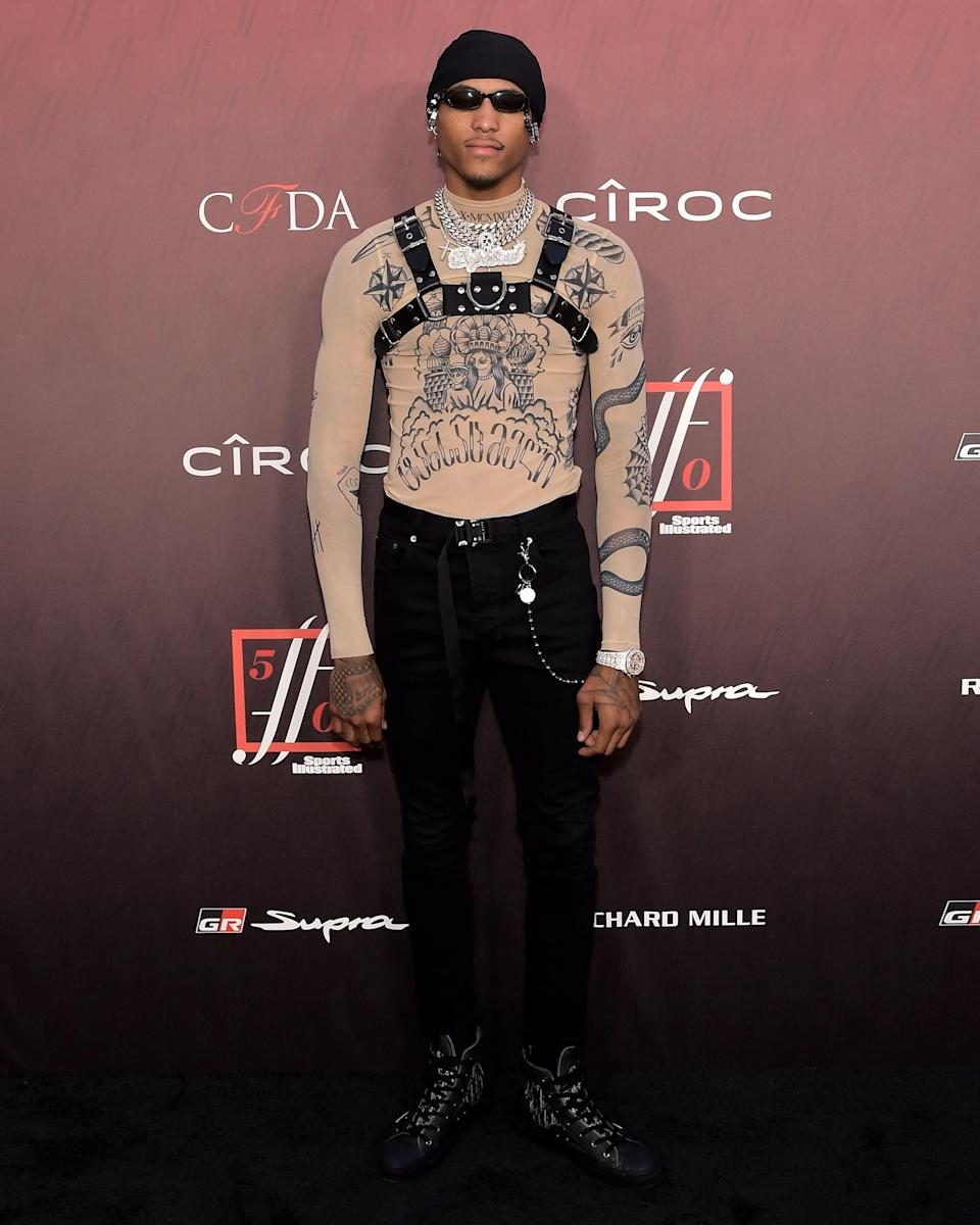 """<h1 class=""""title"""">July 19: Kelly Oubre Jr.</h1> <div class=""""caption""""> Kelly Oubre Jr. singlehandedly pushing the boundaries of the #BigFitoftheDay. </div> <cite class=""""credit"""">Getty Images</cite>"""