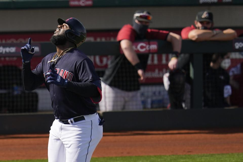 Cleveland Indians' Franmil Reyes looks to the sky as he arrives at home plate after hitting a home run against the Arizona Diamondbacks during the fourth inning of a spring training baseball game Wednesday, March 3, 2021, in Goodyear, Ariz. (AP Photo/Ross D. Franklin)