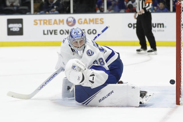 Tampa Bay Lightning goaltender Andrei Vasilevskiy (88) watches a puck shot past him for a goal by New York Islanders' Ryan Pulock during the second period of an NHL hockey game Friday, Nov. 1, 2019, in Uniondale, N.Y. (AP Photo/Frank Franklin II)