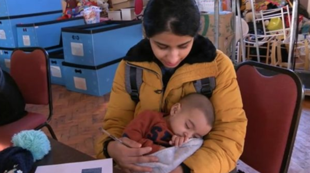 Maria Mohammad, 24, mother to four-month-old Hassan, said she could not afford to buy him a coat (Picture: BBC Midlands Today)