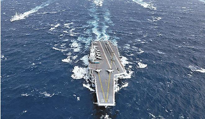 China's first aircraft carrier, the Liaoning, or its sister ship, the Shandong, is expected to be involved in this summer's drills. Photo: Handout