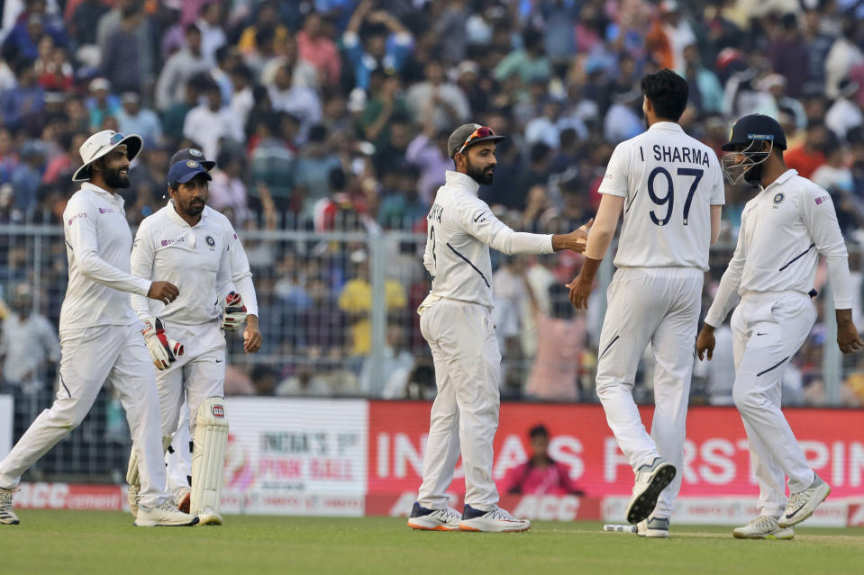 Indian players congratulate teammate Ishant Sharma after he dismissed Bangladesh's Ebadot Hossain during the first day of the second test match between India and Bangladesh, in Kolkata, India, Friday, Nov. 22, 2019. (AP Photo/Bikas Das)