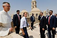 French President Emmanuel Macron (C) tours the Our Lady of the Hour Church in Iraq's second city of Mosul (AFP/Ludovic MARIN)