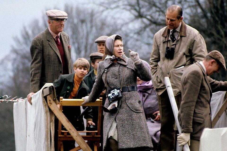 The Duke of Beaufort, Prince Edward, Viscount Linley, The Queen and Prince Philip watch cross-country from a farmcart at the Badminton Horse Trials, 1973.PA