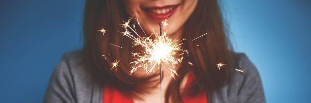 A picture of a woman holding a sparkler.