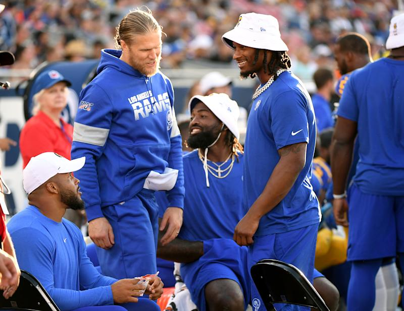LOS ANGELES, CALIFORNIA - AUGUST 24: Todd Gurley #30, speaks with Clay Matthews #52 and Aaron Donald #99 on the sidelines during a preseason game against the Denver Broncos at Los Angeles Memorial Coliseum on August 24, 2019 in Los Angeles, California. (Photo by Harry How/Getty Images)