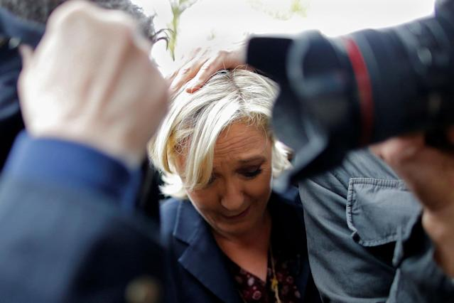 <p>Marine Le Pen, French National Front (FN) party candidate for 2017 presidential election, is protected by bodyguards as eggs are thrown by demonstrators during her arrival in Dol-de-Bretagne, France, May 4, 2017. (Stephane Mahe/Reuters) </p>