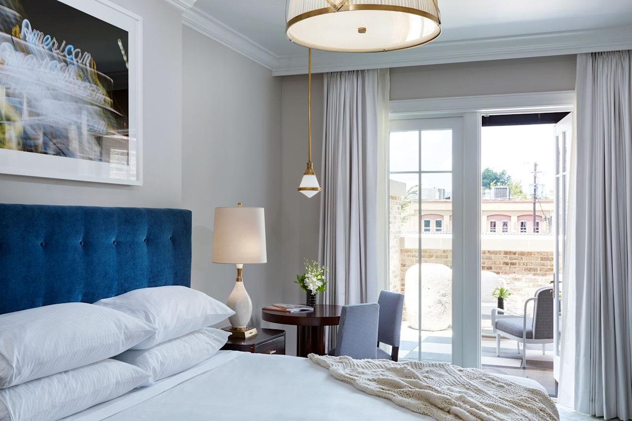<p><strong>How did it strike you on arrival?</strong><br> Immediately south of Charleston's historic market, this boutique hotel attracted instant raves when it opened in the summer of 2015. The lobby is a stunner, with a gently cascading waterfall wall, hand-painted bird mural, stuffed white peacock, and amethyst-colored drapes, elements all selected to channel 1920s glamour with a contemporary twist. I was greeted with the bartender's daily changing cocktail—in this case, a hibiscus-infused French 75 (pale pink, subtle, and refreshing).</p> <p><strong>What's the crowd like?</strong><br> Couples, business travelers, girls' getaways.</p> <p><strong>The good stuff: Tell us about your room.</strong><br> I reserved a Grand Suite for its soaking tub separate. I loved the azure-blue tufted velvet headboard on my four-poster bed and slept very, very well despite the hotel's proximity to such a bustling tourist area. Deep Steep bath products are one of Charleston's best-kept local secrets, so I was pleased to see them in a hotel setting.</p> <p><strong>How about the little things, like the mini bar, or shower goodies? Anything that especially stood out to you?</strong><br> Heated towel racks, sparkling white Carrara bathroom vanities. Espresso machines in every room. Contemporary artwork, including a photograph of an iconic Charleston movie theater, all sourced through a local artist collective. Soft jazz music (Ella Fitzgerald, Frank Sinatra) on arrival and at turndown. Complimentary boozy cordial at turndown. Free Wi-Fi. A good representation of local producers in the mini-bar, including key lime cookies, benne wafers, and South Carolina-grown peanuts, and all (gasp) complimentary and restocked daily. I did not want to part with my dreamily plush, thick velour bathrobe. And I wouldn't mind making off with the taxidermy white peacock in the library-bar.</p> <p><strong>Room service: Worth it?</strong><br> The hotel does not have a restaurant, and that's a common complaint given the hype surrounding the hotel's launch. However, the cocktail lounge launched a tasty bar snack menu in February 2019 with inventive, seasonal, savory tarts and other salty bites available both as bar snacks and as room service delivery from 4-10pm. An ample continental breakfast is brought to the room on trays, and your room is restocked with free snacks daily. Multiple restaurants fall within a one- to two-block range¸, from which your assigned personal butler can pick up food and deliver to your room for a 20 percent surcharge.</p> <p><strong>Anything we missed?</strong><br> Bartender Allen Lancaster bristles at the term 'mixologist,' but he is creative indeed, incorporating things like grapefruit bitters, chamomile-lemongrass honey, orange blossom and rosewater perfume into his daily concoctions. Bar chairs sport green leather and skinny brass legs, and the marble bar is smooth as suede. Low-slung seating configurations make this a very popular gathering spot for locals and guests.</p> <p>I should also mention the complimentary hotel bikes come with maps, water bottles, and built-in wicker baskets. The bar is the hotel's greatest strength, both in design and service.</p> <p><strong>Bottom line: Why will we love it here?</strong><br> The stylish bar, vintage elegance, central location, bright rooms, and admirable commitment to local products make The Spectator worth its price. Just don't expect onsite dining.</p>