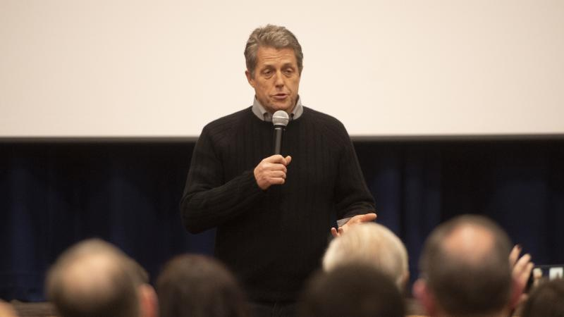 Hugh Grant heckled while campaigning for Labour