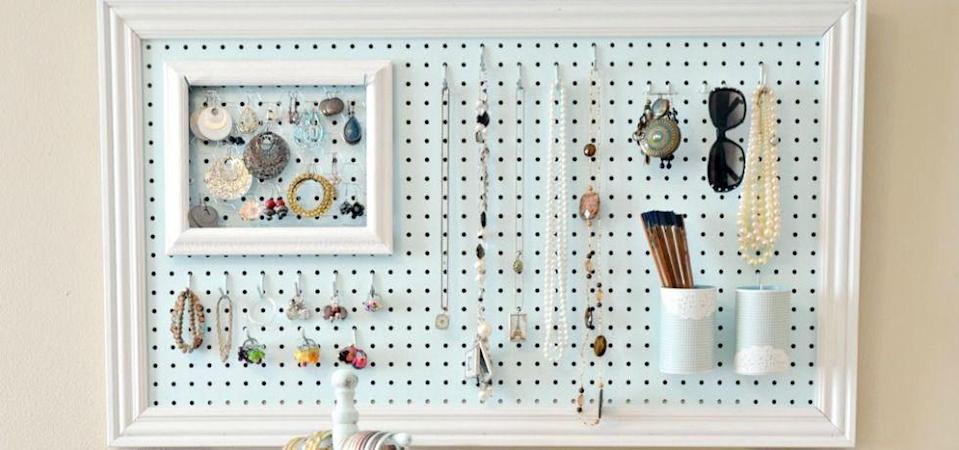 """<p>Eliminate tangles, dents and messy piles when each necklace and earring has an individual hook. By framing the pegboard and painting it a soft, inviting color, it doubles as wall art and doesn't come off as utilitarian-style storage.</p><p><a href=""""http://www.the36thavenue.com/peg-board-and-accessories-station/"""" rel=""""nofollow noopener"""" target=""""_blank"""" data-ylk=""""slk:See more at The 36th Avenue »"""" class=""""link rapid-noclick-resp""""><em>See more at The 36th Avenue »</em></a></p>"""