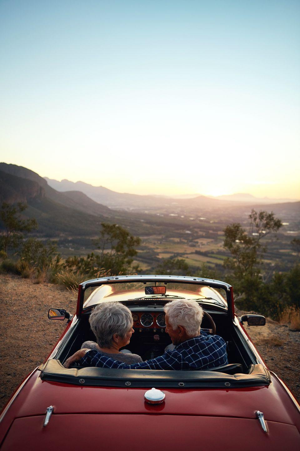 """<p>Because you're saving money by not traveling for your vacation, treat yourself to renting a car that you've always dreamed of for a few hours. A convertible is a great idea for a warm, sunny day to take a drive and watch the sunset.</p><p><a class=""""link rapid-noclick-resp"""" href=""""https://www.amazon.com/SOJOS-Sunglasses-Mirrored-SJ2057-Tortoise/dp/B07CGM6RG2/?tag=syn-yahoo-20&ascsubtag=%5Bartid%7C10050.g.805%5Bsrc%7Cyahoo-us"""" rel=""""nofollow noopener"""" target=""""_blank"""" data-ylk=""""slk:SHOP SUNGLASSES"""">SHOP SUNGLASSES</a> </p>"""
