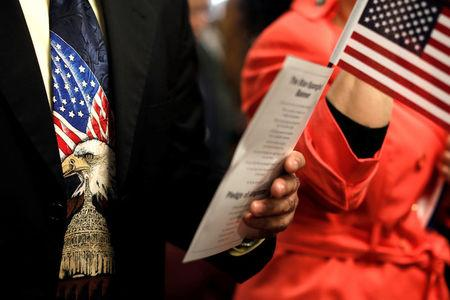 New American citizens take the Oath of Allegiance during a naturalization ceremony in Newark