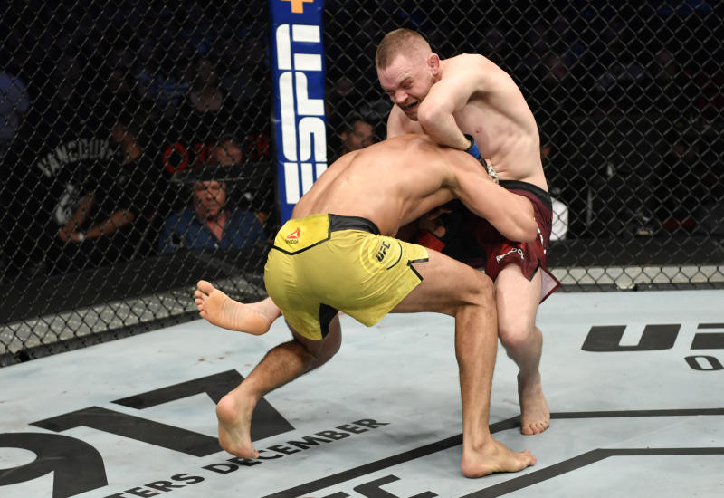 VANCOUVER, BRITISH COLUMBIA - SEPTEMBER 14: (R-L) Tristan Connelly of Canada attempts to secure a guillotine choke submission against Michel Pereira of Brazil in their middleweight bout during the UFC Fight Night event at Rogers Arena on September 14, 2019 in Vancouver, Canada. (Photo by Jeff Bottari/Zuffa LLC/Zuffa LLC)