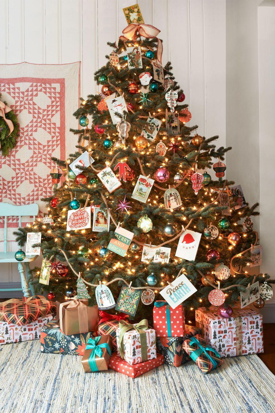 <p>Whether you display all the greetings that come through the mail or buy vintage postage at the store, this antique-style tree is bound to make the spirits bright. </p>
