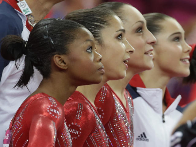 U.S. gymnasts, from left to right, Gabrielle Douglas, Alexandra Raisman, Jordyn Wieber and McKayla Maroney watch the screen moments before the results were declared during the Artistic Gymnastic women's team final at the 2012 Summer Olympics, Tuesday, July 31, 2012, in London. Team U.S. won the gold medal. (AP Photo/Julie Jacobson)