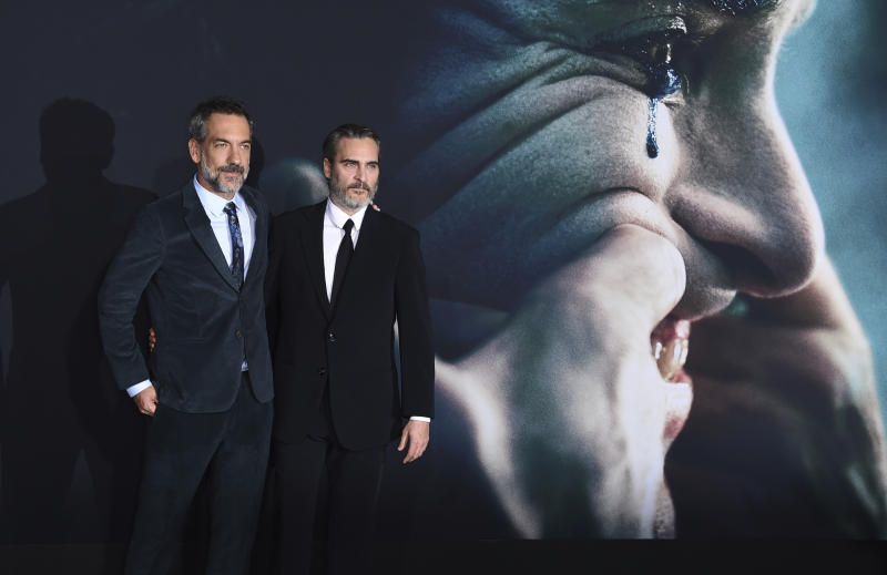 "Director Todd Phillips, left, and cast member Joaquin Phoenix arrive at the Los Angeles premiere of ""Joker"" at TCL Chinese Theatre on Saturday, Sept. 28, 2019. (Photo by Jordan Strauss/Invision/AP)"