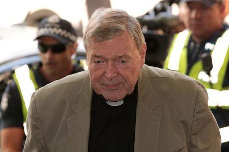 Cardinal George Pell arrives at the Melbourne Magistrates Court in Melbourne, Australia, March 5, 2018. AAP/Stefan Postles/via REUTERS