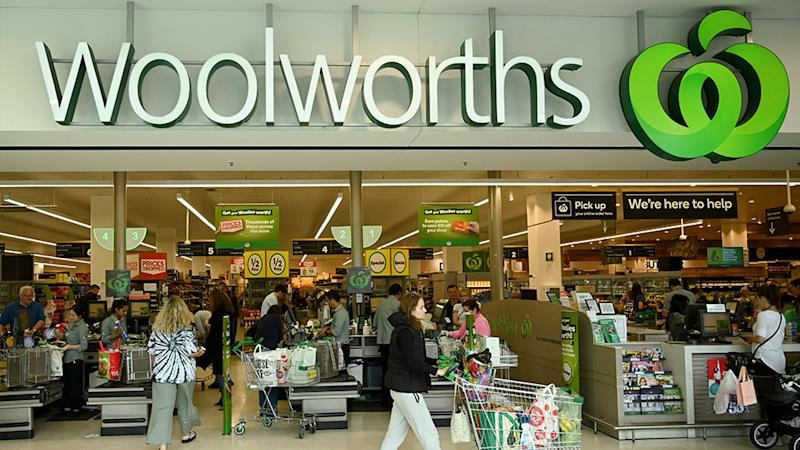 People shop at a Woolworths supermarket in Sydney on March 17, 2020. - Australia's elderly were let in early to supermarkets on March 17, but coronavirus panic buying still proved too much in some areas, with reports of empty shelves and large queues.