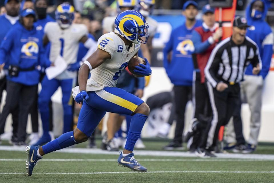 Rams wide receiver Robert Woods runs with the ball.